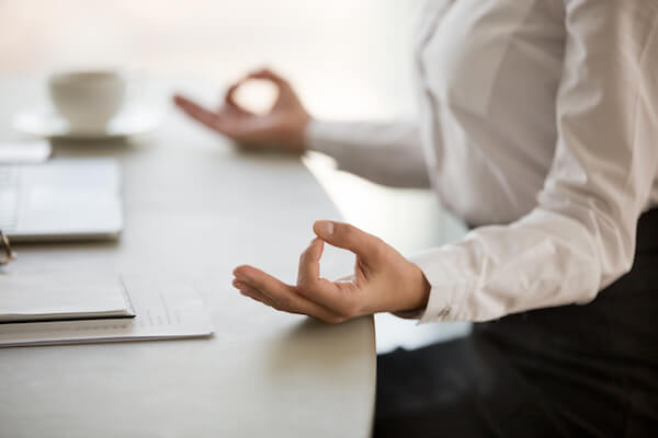 office worker practising mindfulness