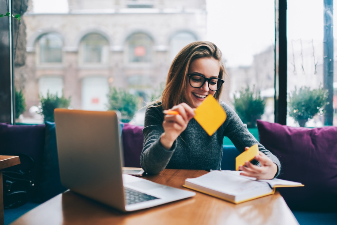 smiling woman being more productive at work
