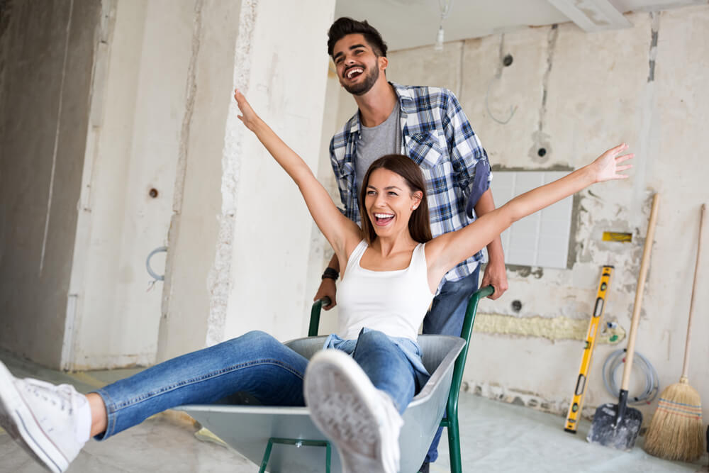 happy couple renovating house